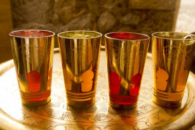 Arab peppermint tea golden glasses over golden tray