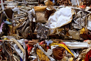 Iron scrap metal compacted to recycle