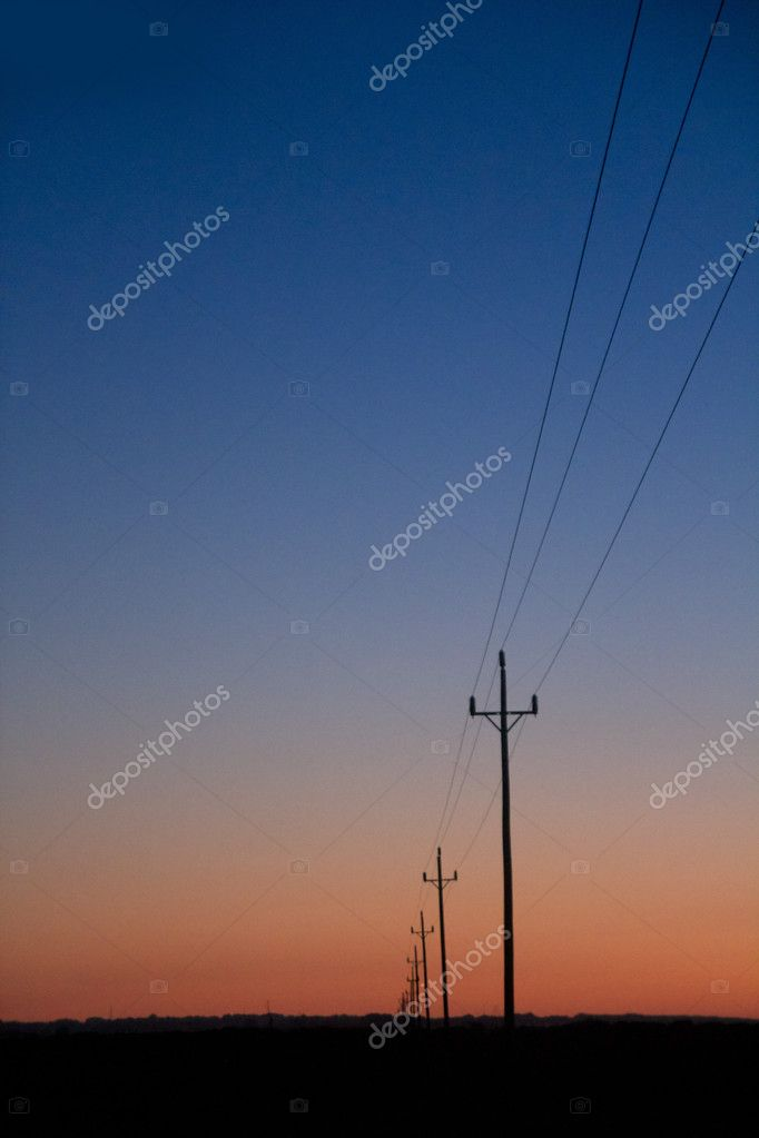 Electric power lines in sunset blue red orange