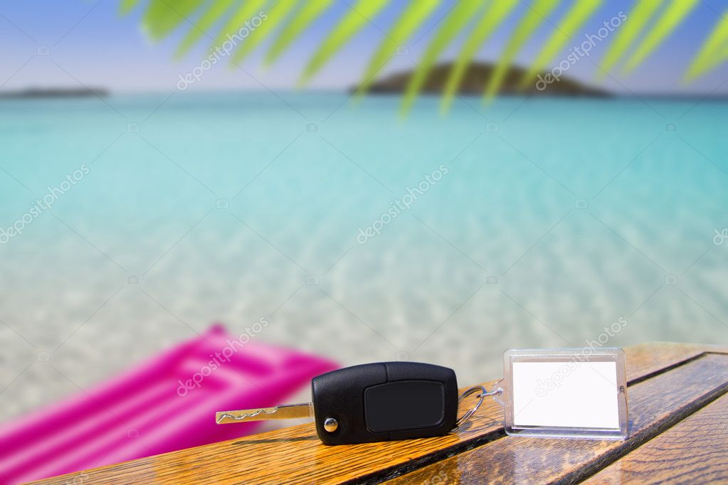 Car rental keys on wood table in vacation Caribbean