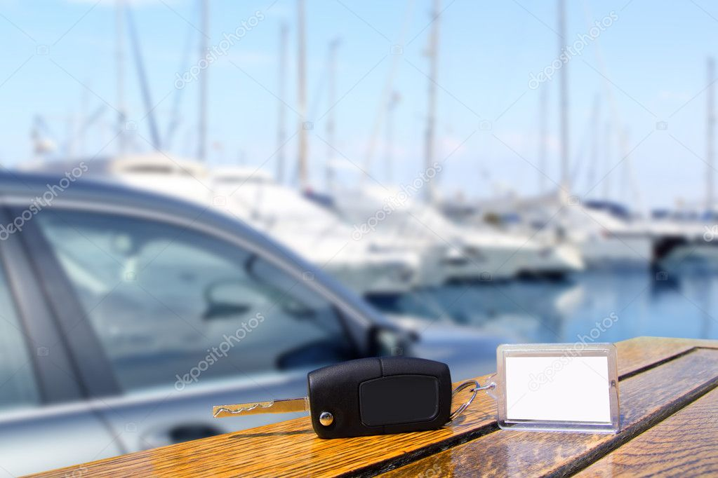 Car rental keys on wood table in Mediterranean vacation