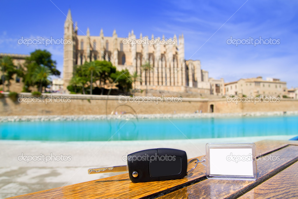 Car rental keys on wood table in Palma de Mallorca cathedral