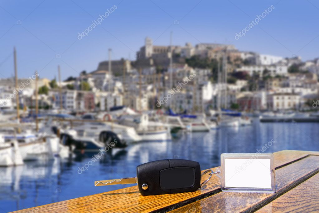 Car rental keys on wood table in Ibiza town