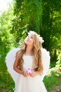 Angel children girl holding flower in hand looking sky
