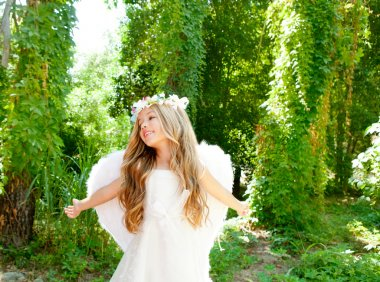 Angel children girl open arms in forest white wings