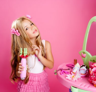 Hairdresser blond fashion doll girl with hair curler