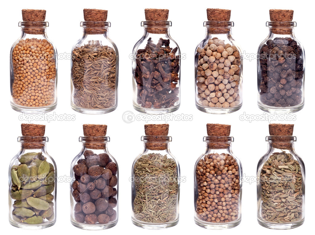 Assortment of different spices in glass bottles