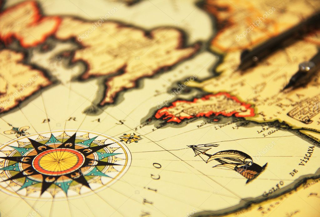 Ancient world map and compass