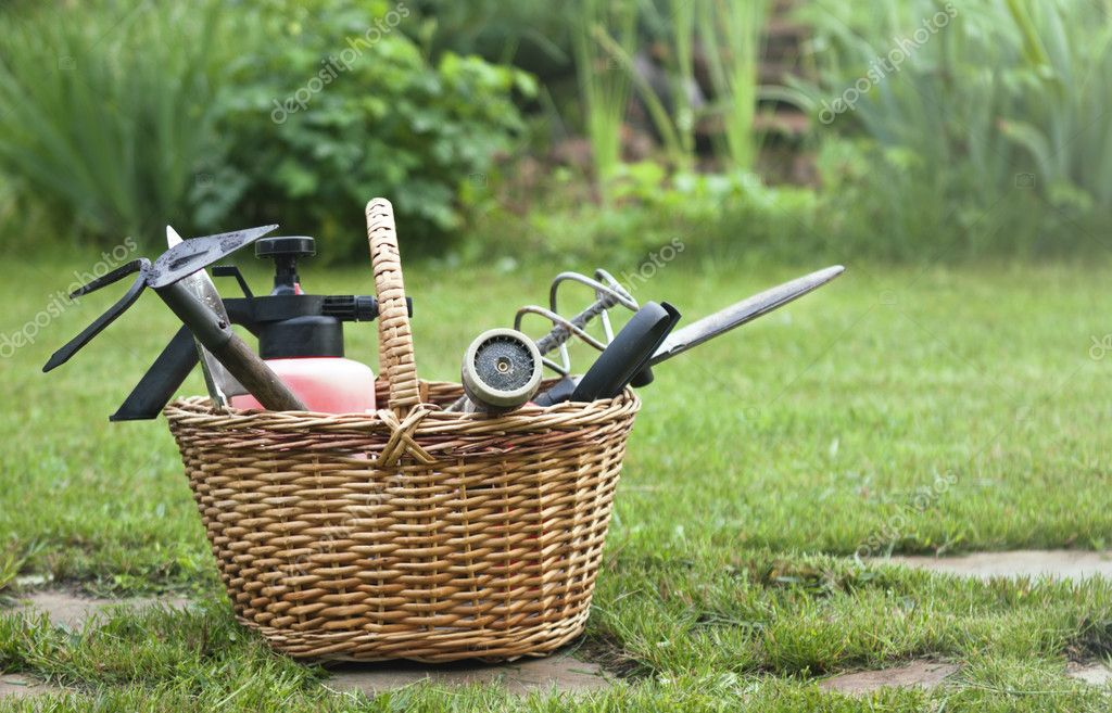 Gardening tools (hoe, splash pad, garden pruner ect) in a basket