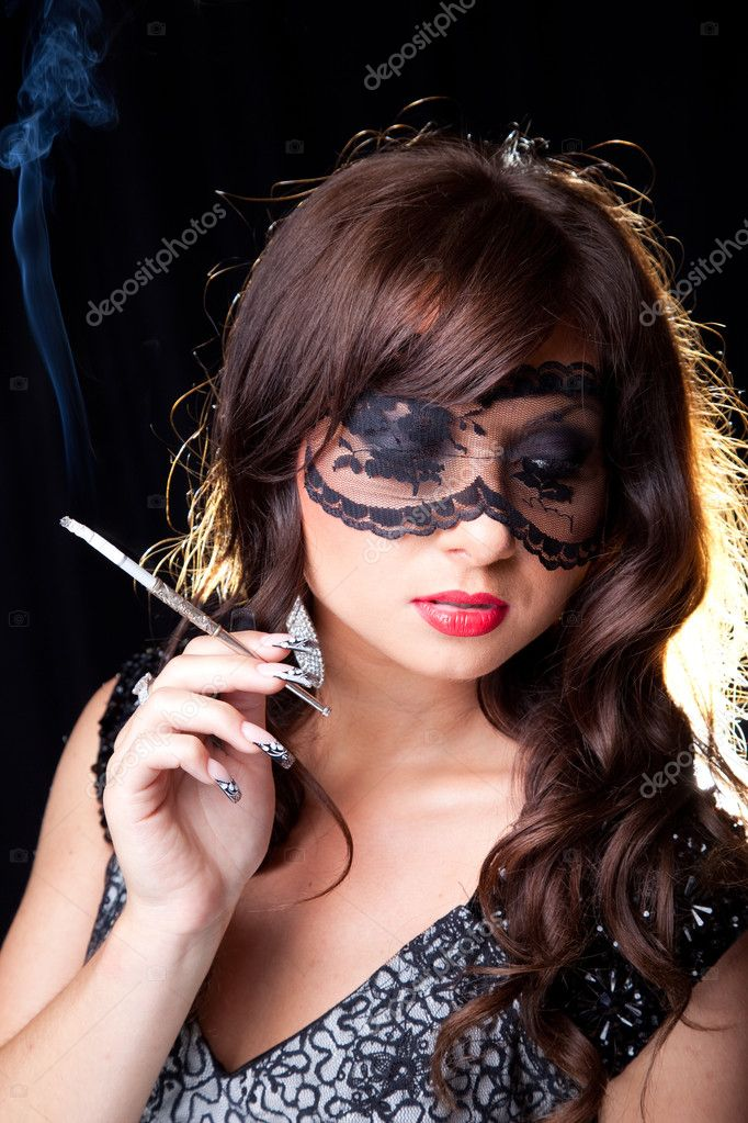 https://static6.depositphotos.com/1057741/650/i/950/depositphotos_6500255-stock-photo-smoking-lady-with-lacy-mask.jpg