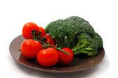 rajčata a zelí na desku