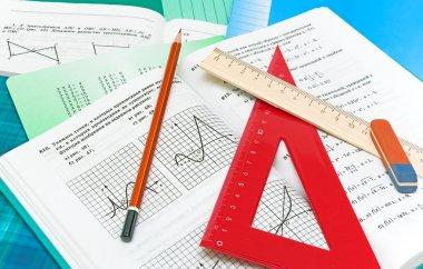 Mathematics textbook, notebook, pencil and ruler