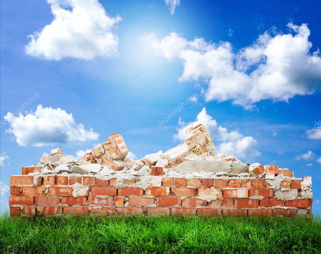 Broken Brick Wall on grass