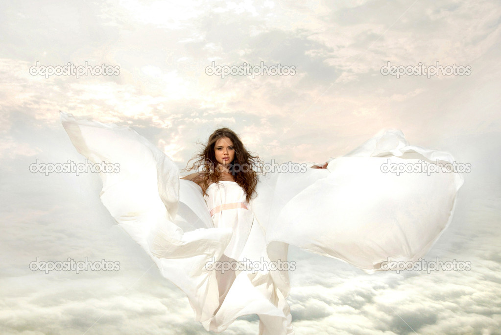 Fairy young women to ascend into Heaven. female looks angel with
