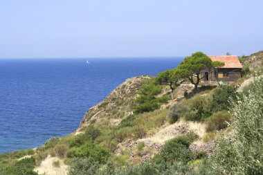 Lonely house on the hill by the sea