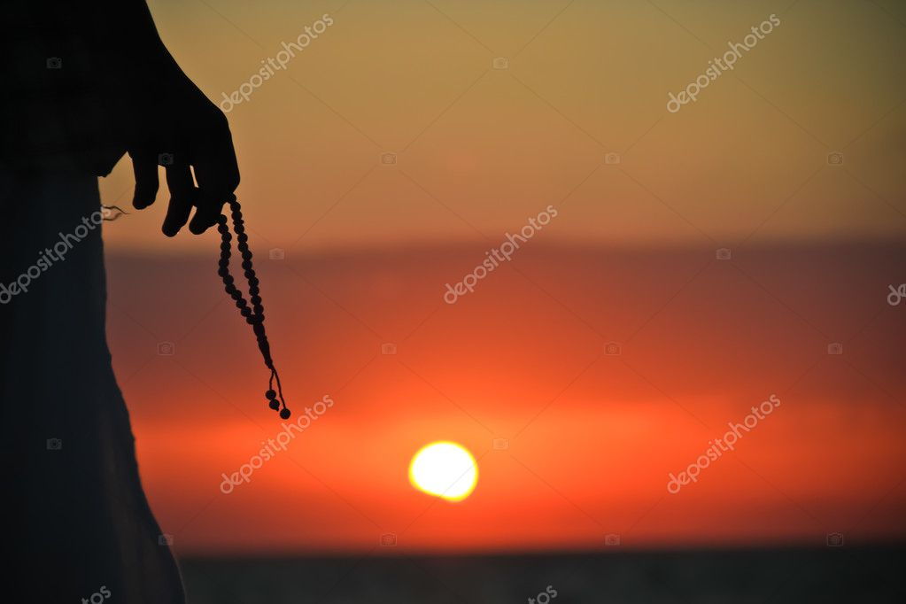 Rosary in the hand