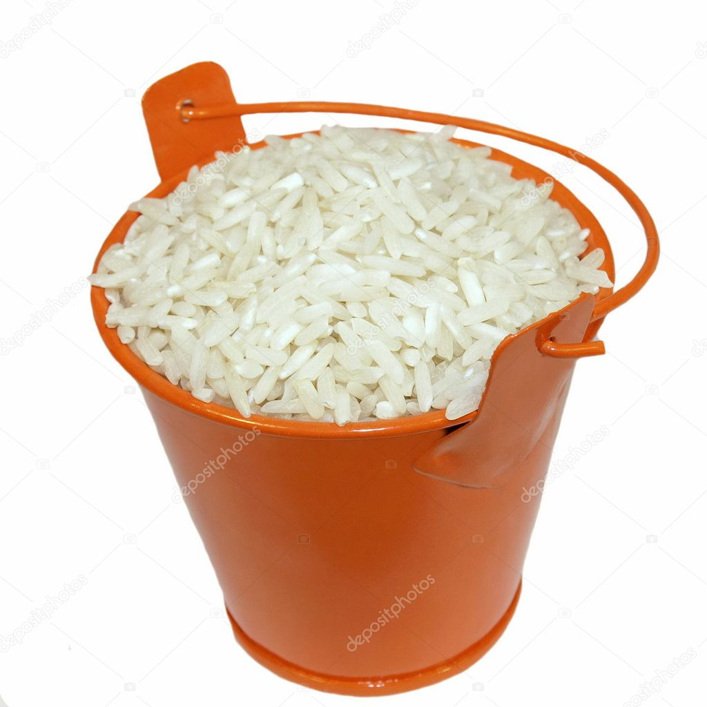 Bucket and Long white rice on white background
