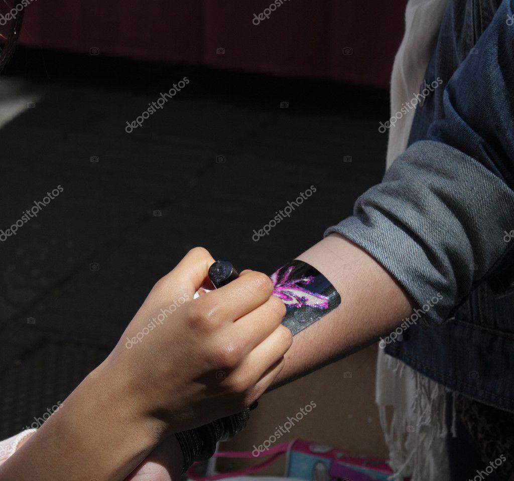 depositphotos_5473877-stock-photo-tattoo-on-arm.jpg