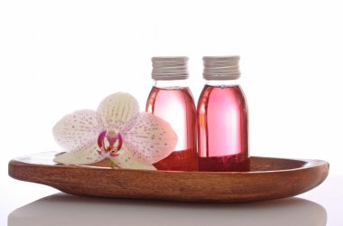 Bottles with essential oils and orchid