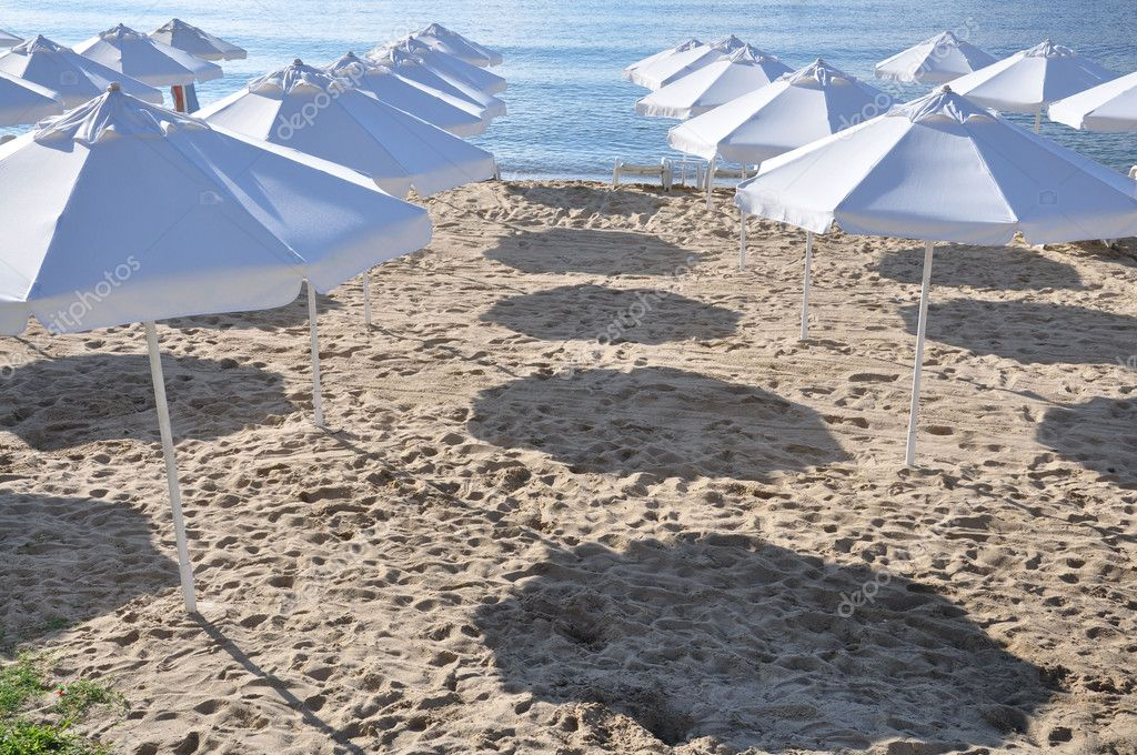 White umbrellas on the beach.