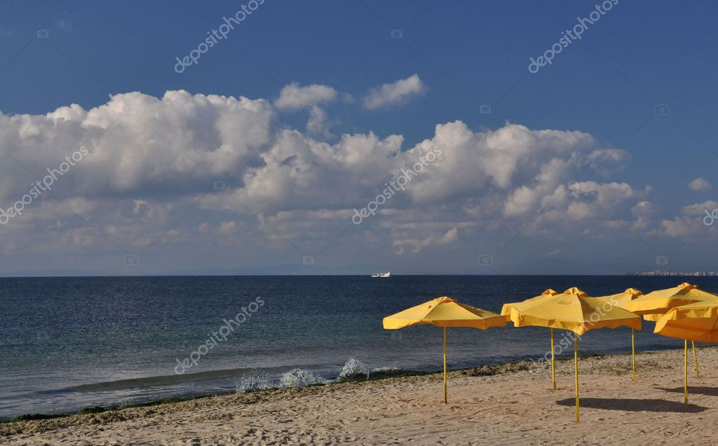 Yellow umbrellas on the beach.