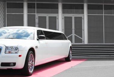 White limousine near office building