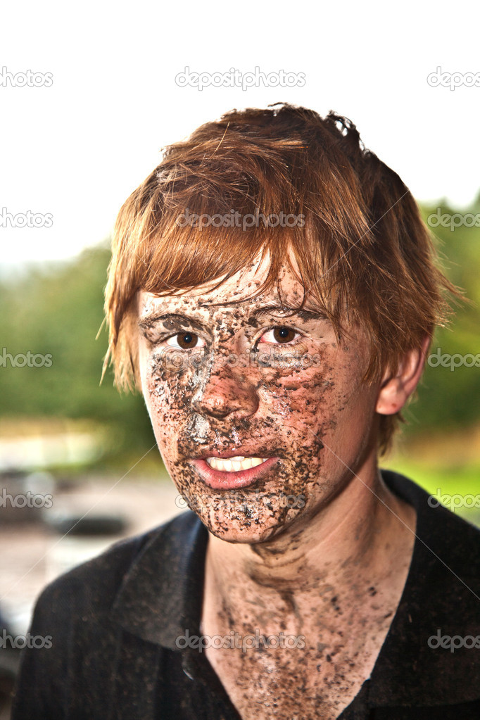 Boy has dirt in his face from driving Quad