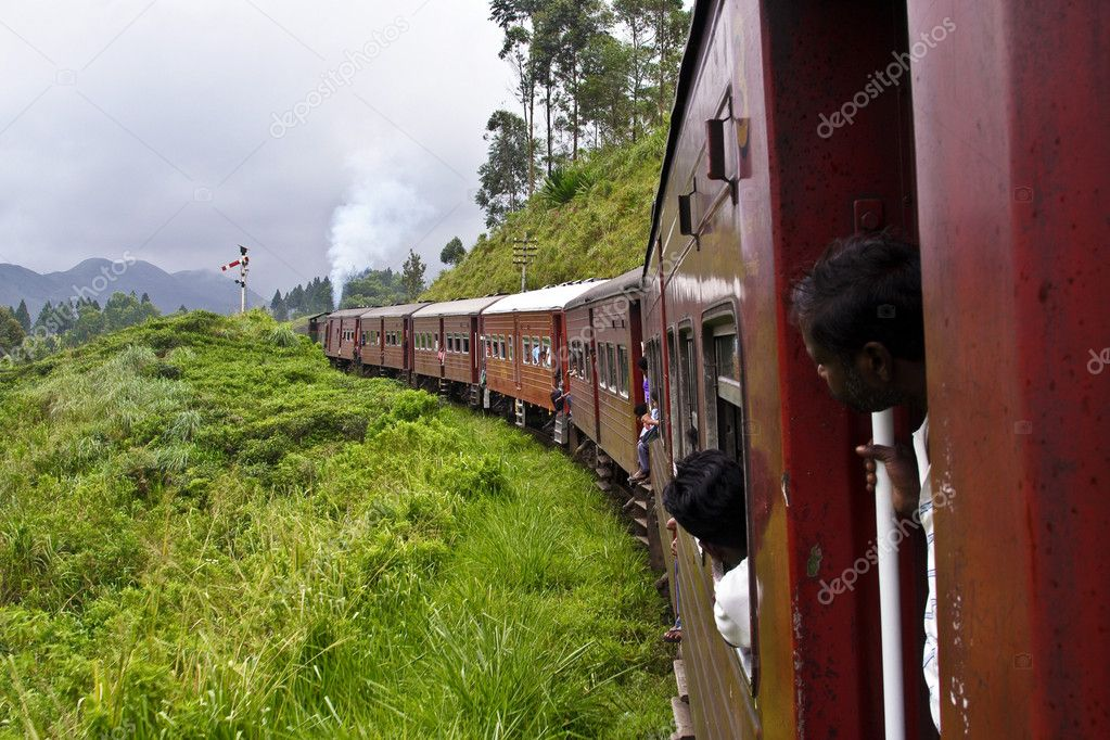 Boy looking out of the railway in scenic landscape in Sri Lanka