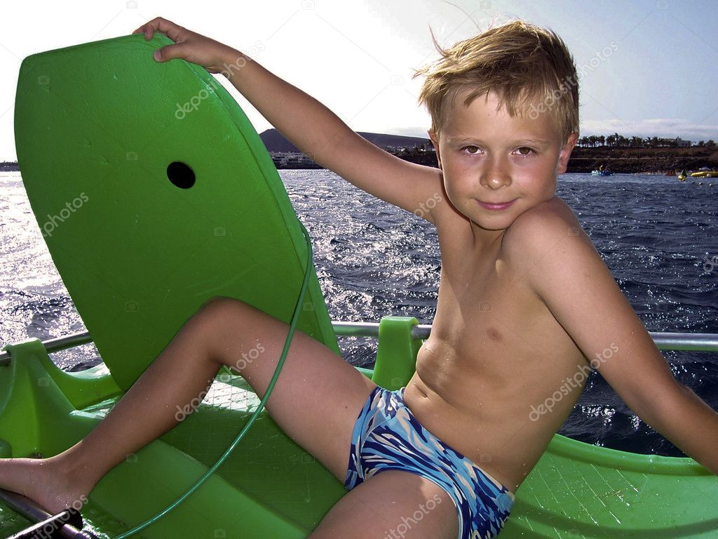 Young boy is surfing in the ocean