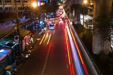 Light beam at night from cars at the main road