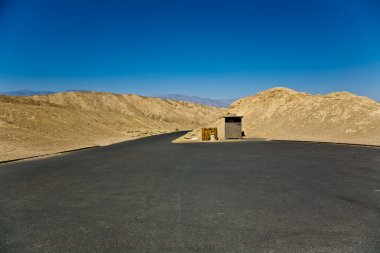 Scenic road Artists Drive in Death valley, empty parking place