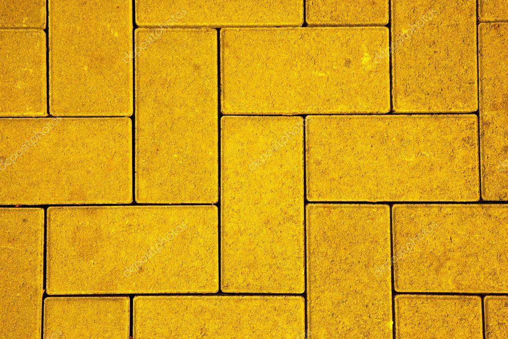 patrn de pavimento hecho con bloques de hormign fundido en color amarillo u fotos de stock