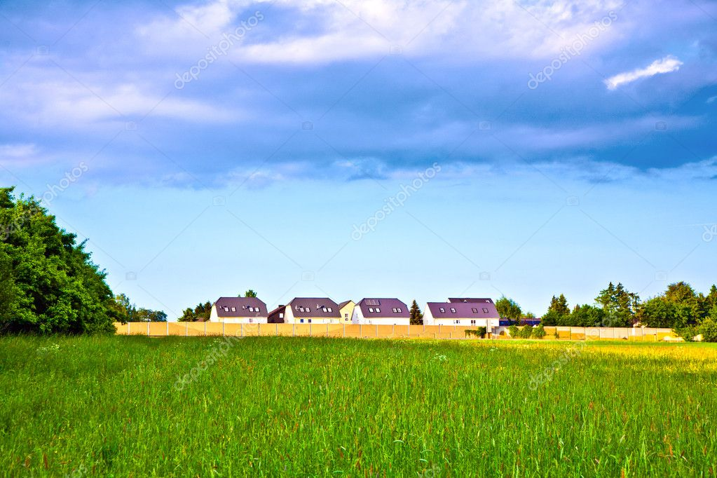 Noise protection wall with field and houses