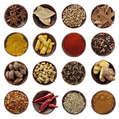 Collection of spices in small wooden bowls, isolated on white. From top left: Star anise, bay leaves, coriander seeds, cinnamon bark, curry powder, turmeric fin stock vector
