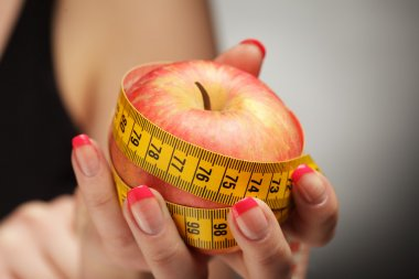 Diet apple in woman hand