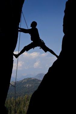 Rock climbing an overhanging face.