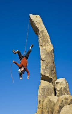 Rock climber falling upside down.