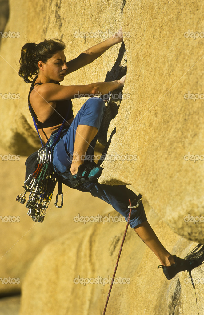 Cheerful female climber on challenging route — Stock Photo