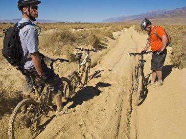 Two men mountain biking.