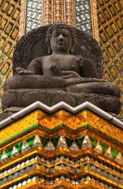 Black Buddha statue in temple of emerald Buddha