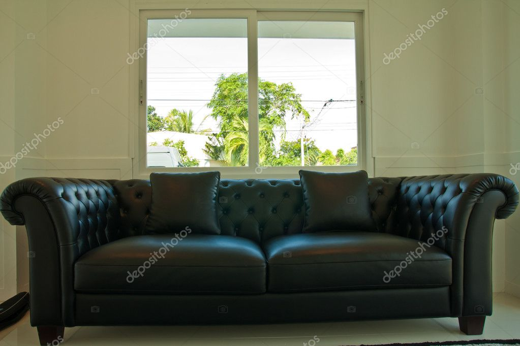 Black Leather Couch In Front Of Windows Stock Photo Atthapols