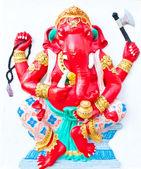 Red ganesha on white wall