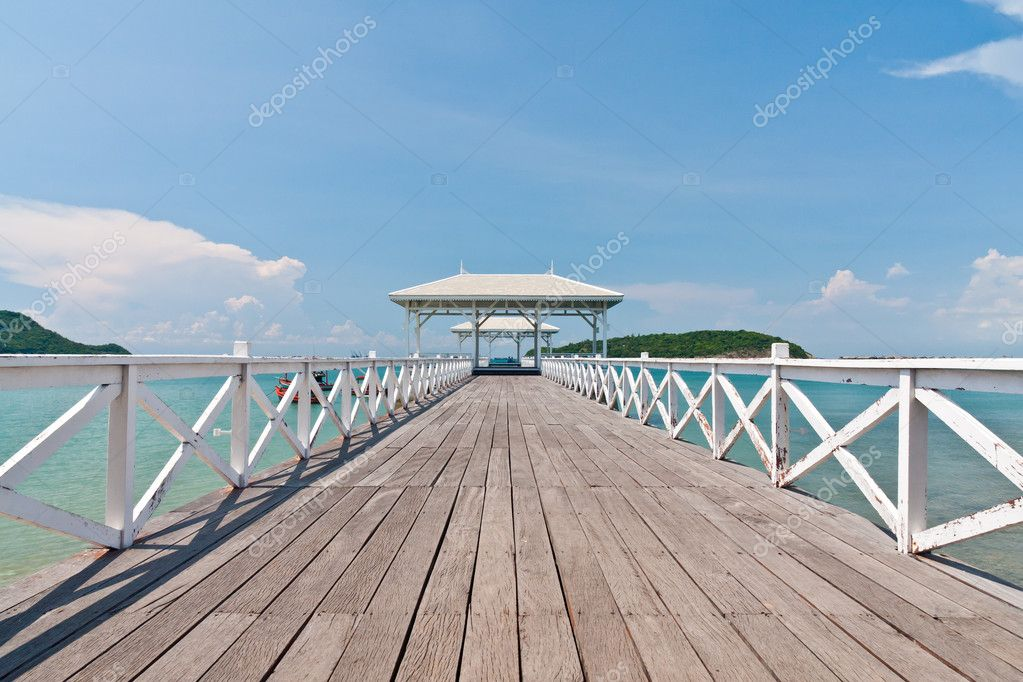 White bridge in to the sea with blue sky