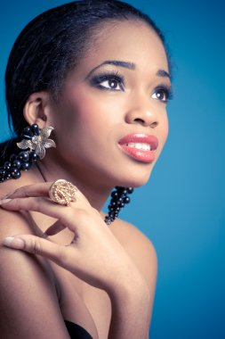 Studio portrait of young black woman