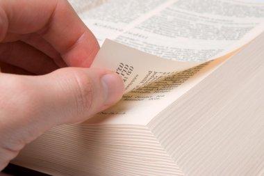 Male hand browse through the open book stock vector