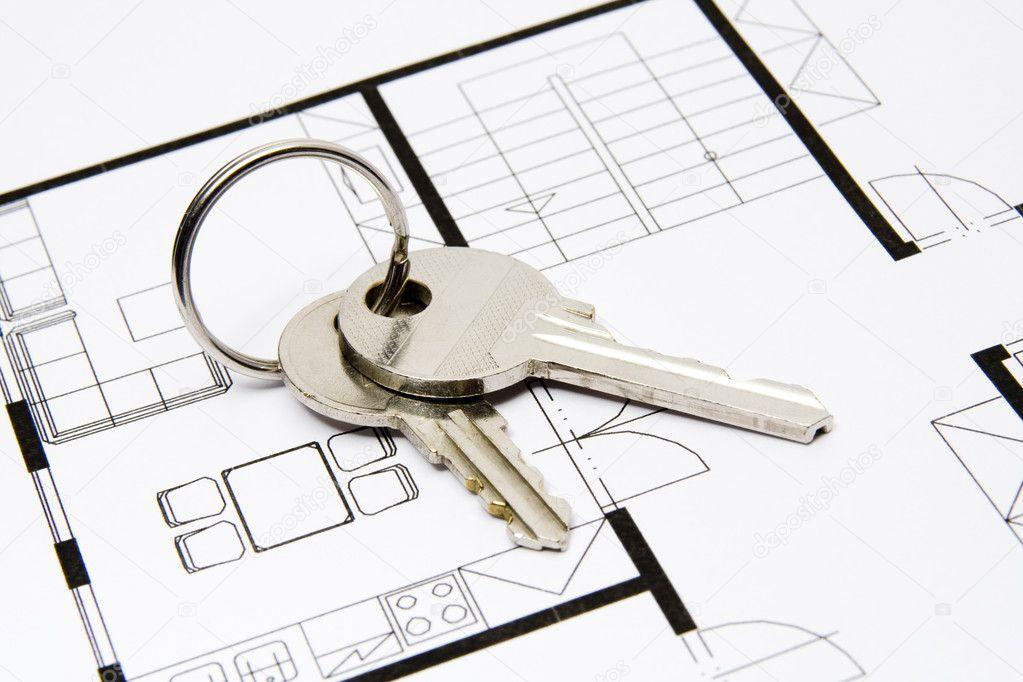 Key to housing stock photo jirsak 5866180 key situated on blueprint of house estate agency photo by jirsak malvernweather Images