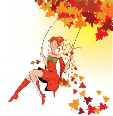 beautiful autumn girl on swing