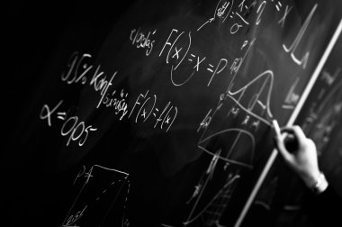Writing on chalk board in black and white