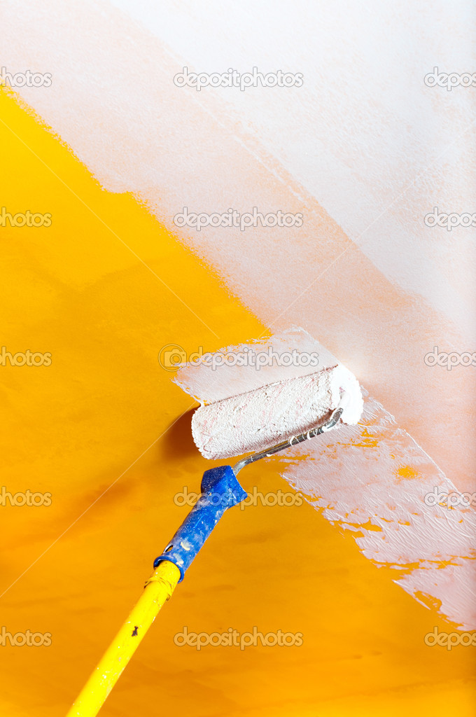 White paint over yellow wall with painting rod — Stock Photo ...