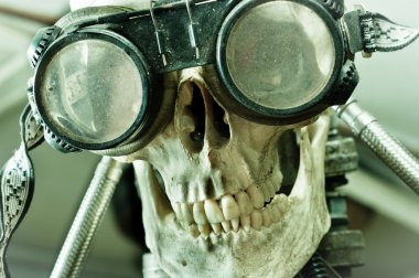 Human skull with insane look and goggles (robot)